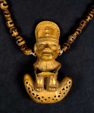 A Pre Columbian Tairona Gold Figural Amulet Necklace