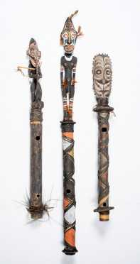 Three Papua New Guinea Flutes with Carved Figural Stoppers