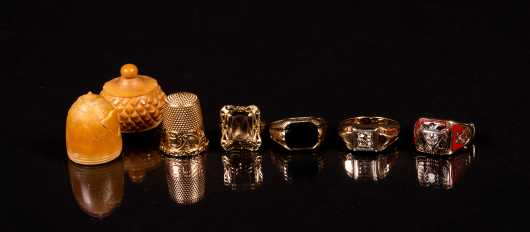 Four Yellow Gold Rings and One 14K Thimble