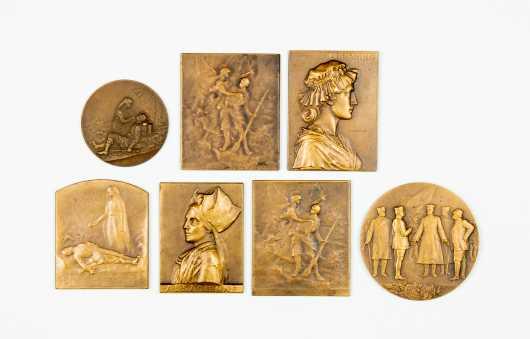 Lot of Seven Bronze Plaques