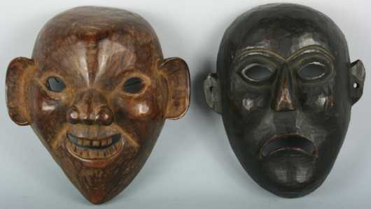 Two Tibetan or Nepalese Carved Masks