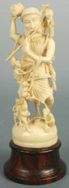 Carved Ivory Figure of a man playing the flute