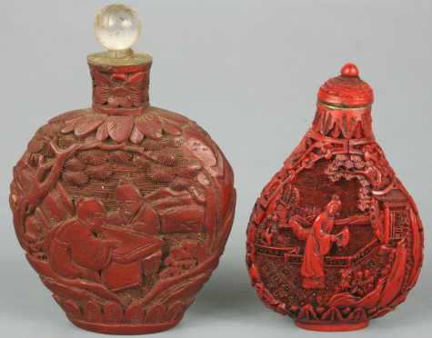 Two Oriental Cinnabar Snuff Bottles