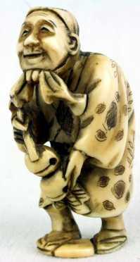 Ivory Katabori Netsuke of a Comedic Figure of a man
