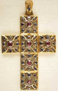 Yellow Gold Cross Pendent, inset with 6 rubies and 48 small sapphires