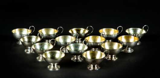 Fourteen Swedish Hammered Sterling Silver Punch Cups