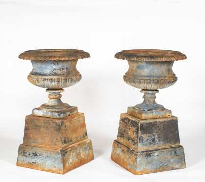 Pair of Bulbous Cast Iron Urns with Canted Bases
