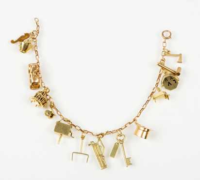 10K Yellow Gold Charm Bracelet with Fourteen Charms
