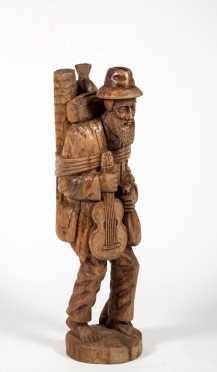 Swiss/ German Wooden Sculpture of a Traveling Musician