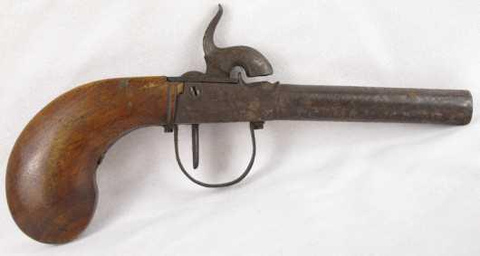 Antique percussion cap pistol with walnut grip