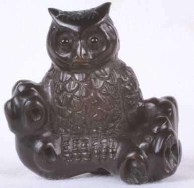 Carved Owl Netsuke sitting on a log