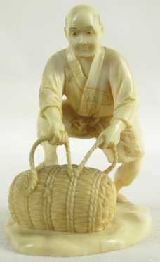 Japanese Ivory Miniature Carving of a Peasant