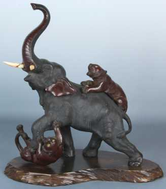 Japanese Bronze Elephant with ivory tusks being attacked by 2 tigers