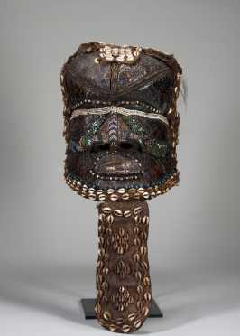 A Kuba Bwoom helmet mask