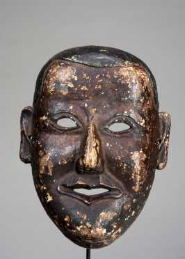 Mask depicting a young monk
