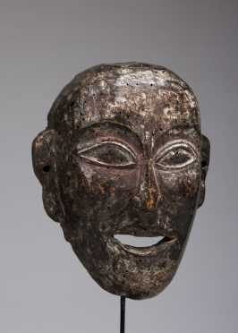 A mask depicting a young monk