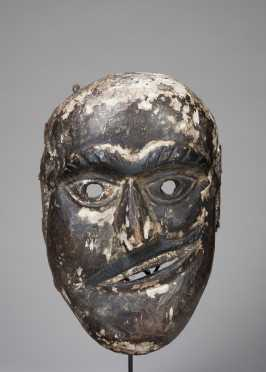 A Shamanic mask with twisted mouth
