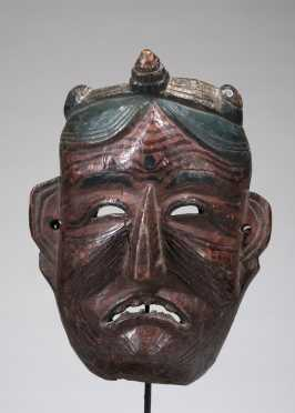 Mask depicting an old grimacing woman
